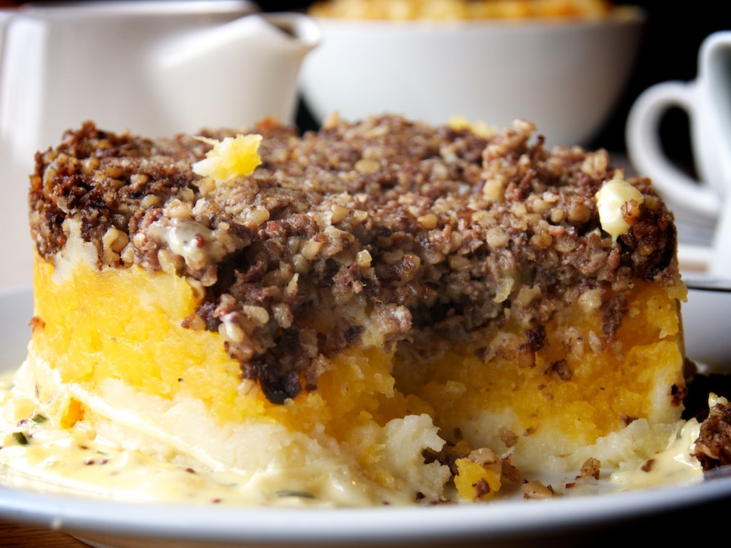 Close-up shot of a plate of haggis, national dish of the Scots