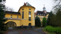 Large yellow building with church spire conspires to inspire insipid insurgents