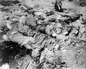 Dead workers lie in uneven rows on floors of barracks, found by American 3rd Armored Div., FUSA when it captured the German slave labor camp at Nordhausen.