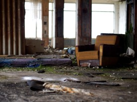 Comfy chair in a very derelict room