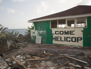 Rubble and broken glass welcome visitors to the heliport reception yard