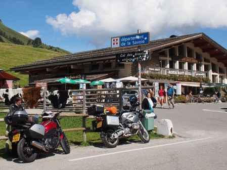 Bikes parked next to sign marking Col des Aravis