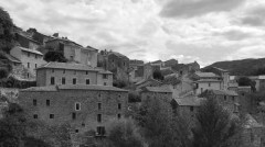 Black and white photo showing rustic looking hillside town