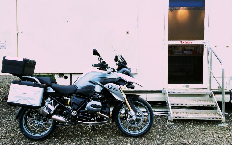 New shiny BMW Motorrad outside a portacabin