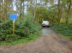 A 4x4 drives past a sign stating 'Not Suitable For Vehicles'