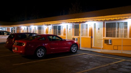 A car parked outside a classic American motel