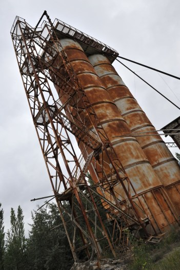 Two tall rusty cylinders formerly used to store cement