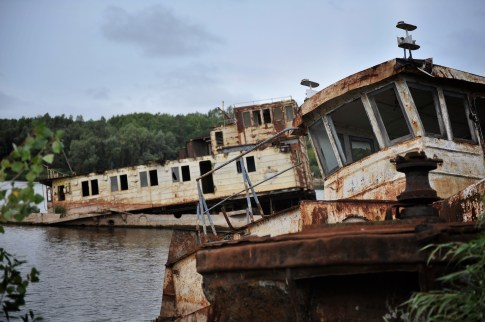 Two old boats rusting on the Pripyat river