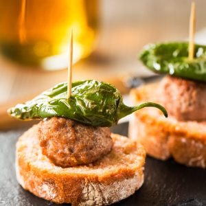 Meatball tapas with vertical copy space.