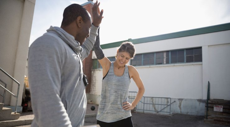 Personal trainer high fiving his client
