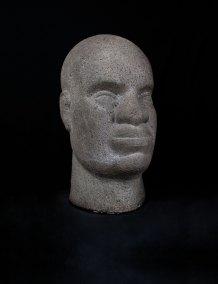 """""""Cabeza de negro"""" Ca. 1950 : piedra chiluca 47 x 26 x 32 cm"""