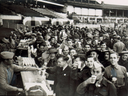 US and Australian soldiers get a drink at the MCG, during WWII