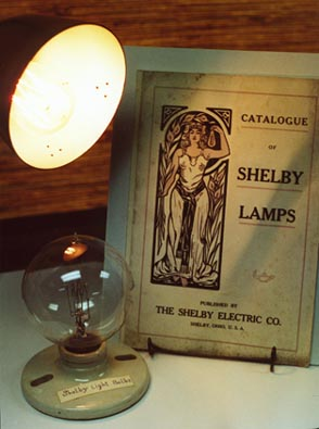 A Shelby Electric Co light bulb, and advertising pamphlet