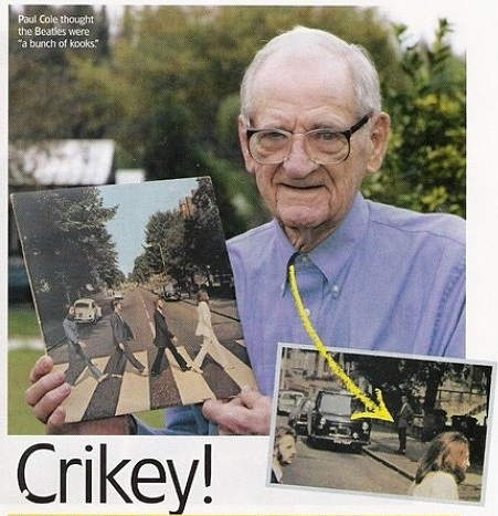 Paul Cole holds a copy of 'Abbey Road'. Cole is the figure in the background of the album.