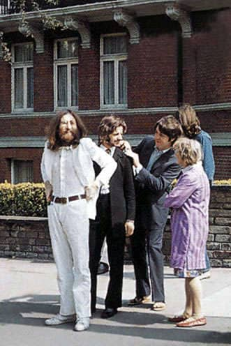 The Beatles get ready to cross Abbey Road, before their famous photo