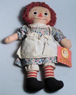 A standard 'Raggedy Ann' doll