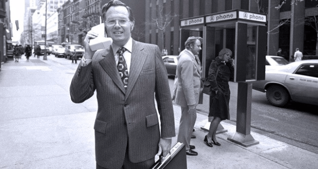 The first mobile phone, in use.