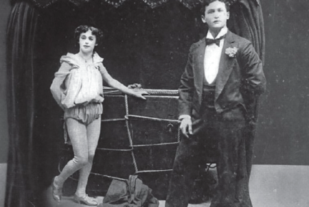 Houdini on stage with his wife, Bess