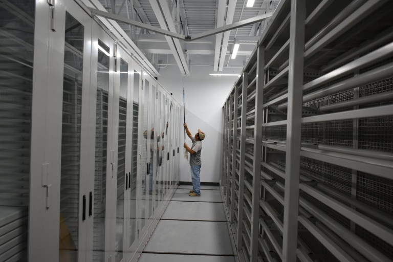 A worker puts the final touches on the new collections storage facility (March 2017).