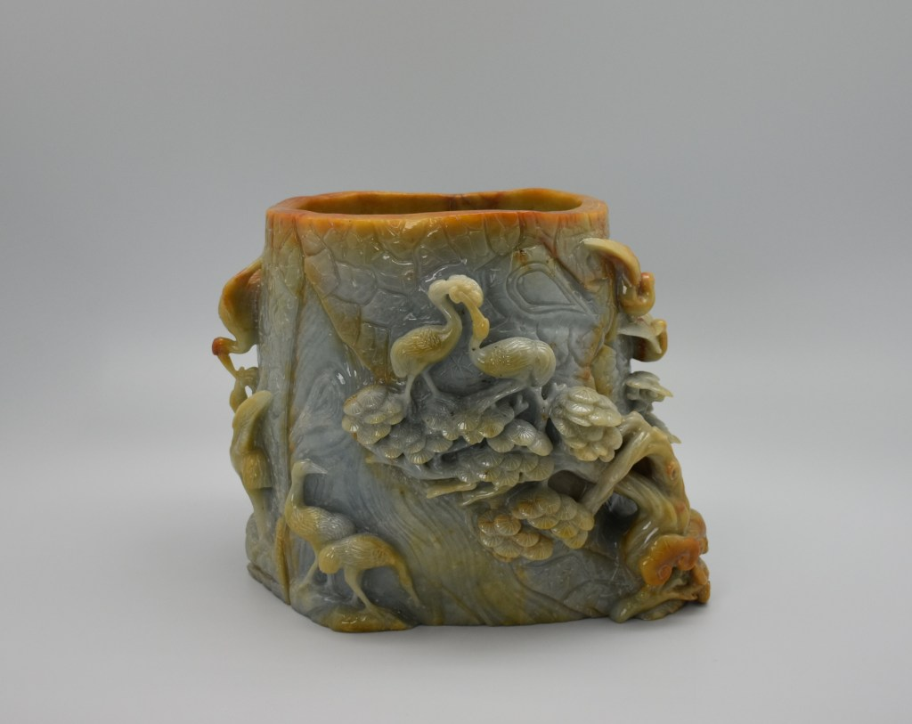A large jade brush holder decorated with cranes and trees