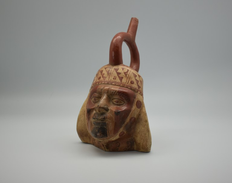 A ceramic sculpted in the shape of a warrior's face