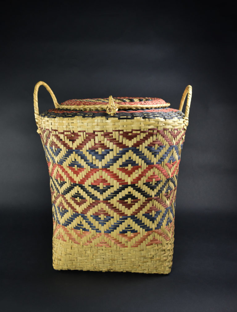 A Choctaw basket featuring a square design known as the cow eye