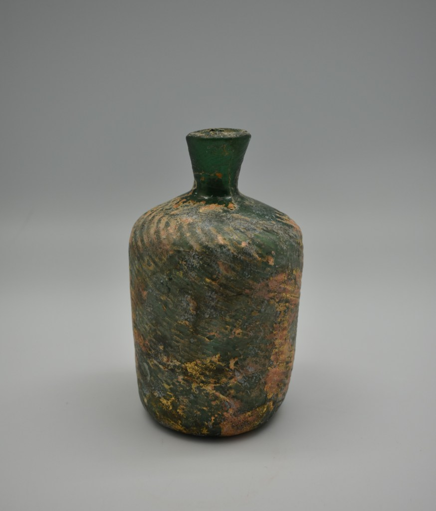 A weathered glass bottle from Palestine (Late Roman Period)