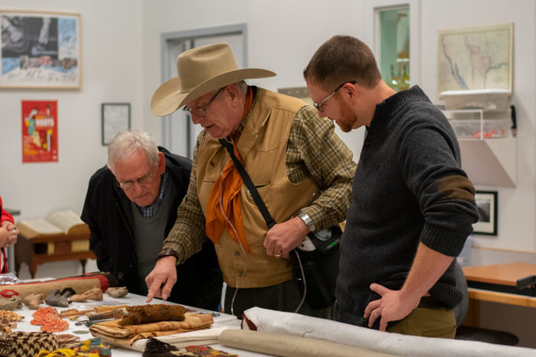 People looking at artifacts