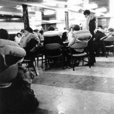 TEV Wahine passengers, in a lounge awaiting instructions after striking Barrett Reef