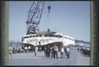 Bridge of TEV Wahine being unloaded onto Pipitea Wharf at Wellington.