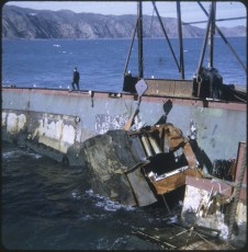 A crane lifting a piece of the TEV Wahine wreck out of the water