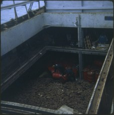 Men working in the  cargo hold of salvage vessel Holmpark at the TEV Wahine wreck.