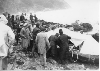 Rescuers searching for survivors in a liferaft on the eastern shore of Wellington Harbour.