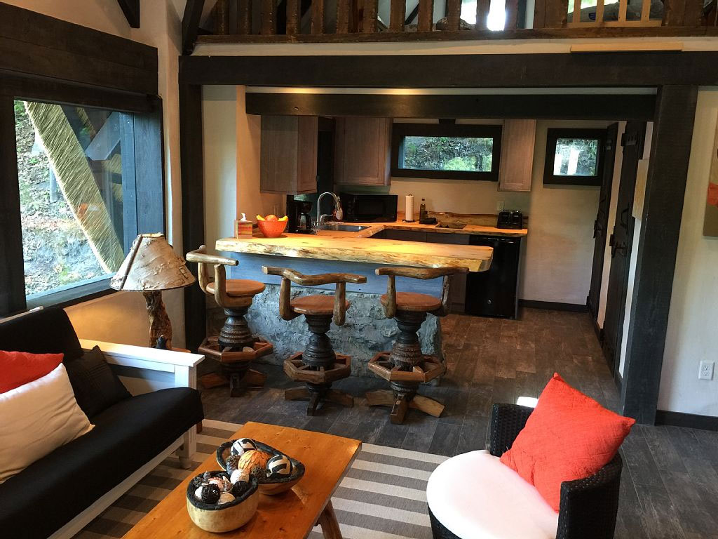 charlevoix-mushroom-house-living-room-kitchen-loft-vacation-rental