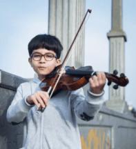 a boy playing the violin