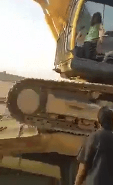 LITTLE GIRL DRIVES AN EXCAVATOR