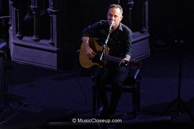 Dave Hause playing electro-acoustic guitar