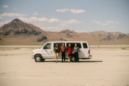 The band Carpool Tunnel outside a minibus in the desert