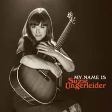 Suzie Ungerleider holding a guitar