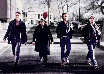 Red Priest band walking on a London street