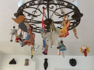 Small angel figures attached to a light fitting