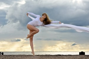 ballerina dancing at the beach