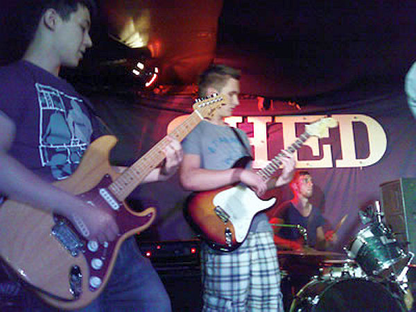 Kieran Kirby (centre) on stage with Cabrillo Beach in 2011