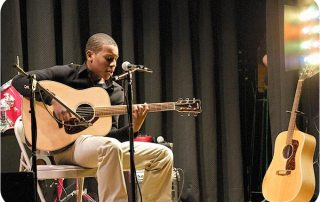 Rock Band Singer-Songwriter, Antoinne, performing solo.