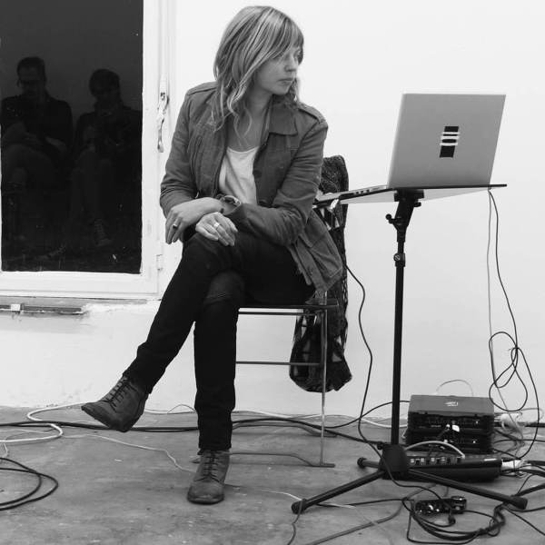 Sabrina Schroeder sitting in front of cables and a laptop