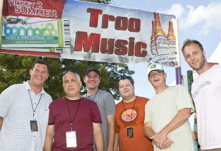 """The Troo Music Tent at the Bonnaroo featured Nashville bands The Features, The Protomen, and Heypenny. In addition to sharing Nashville roots, the three groups also won festival slots through """"The Road to Bonnaroo"""" competition, co-sponsored by BMI, Bud Select, and venue partner, Mercy Lounge. Pictured at the Troo Music Tent are (l-r): BMI Sr. Dir., Writer/Publisher Relations Mark Mason, Bonnaroo co-founder and producer and AC Entertainment President Ashley Capps, Mercy Lounge GM Drew Mischke, BMI Dir. of Writer/Publisher Relations Bradley Collins, BMI Asst. VP Writer/Publisher Relations Clay Bradley, and BMI Assc. Dir., Writer/Publisher Relations Dave Claassen. Photo by Erika Goldring"""