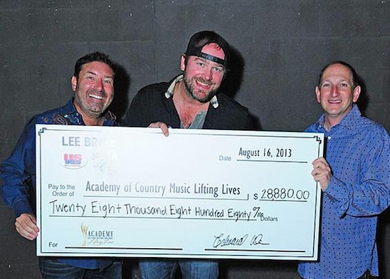 Pictured (L-R): Tommy Disanto, Joe's Bar Co-Owner; Lee Brice; Ed Warm, Joe's Bar Co-Owner and ACM Lifting Lives and ACM Board Member).
