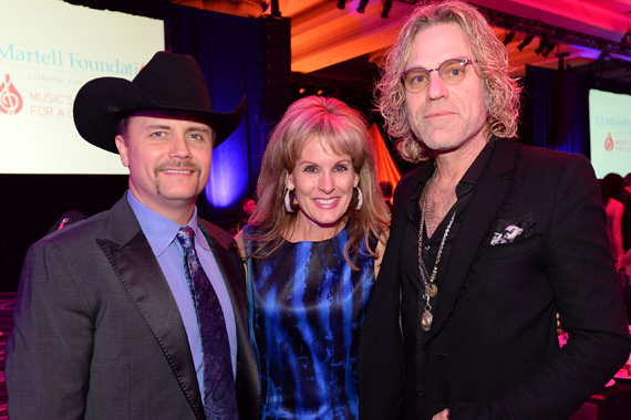 John Rich of Big & Rich, CEO of the TJ Martell Foundation Laura Heatherly, and Big Kenny of Big & Rich. Photo: Rick Diamond/Getty Images