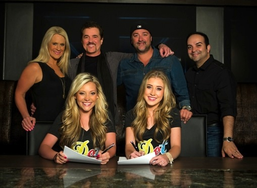 (L-R): Allison Jones, Scott Borchetta, Chris Stacey and Mike Molinar with Maddie and Tae