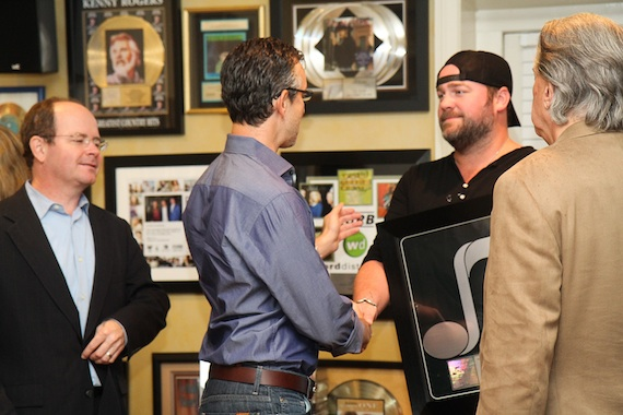 Pictured (L-R): Drew Alexander, David Israelite, Lee Brice, Mike Curb) Photo: NMPA/Bev Moser.